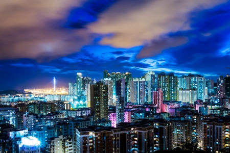 overpopulated: Urban city in Hong Kong at night
