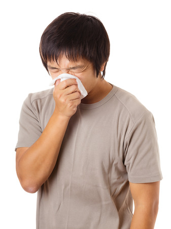 Sneezing asian man photo
