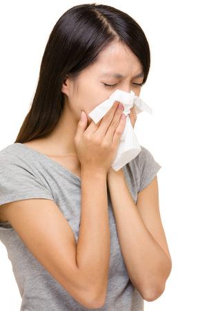 Asian woman sneezing photo