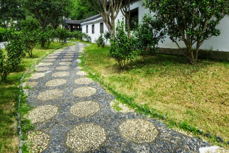 chinese courtyard: Pebble stone path in chinese garden Stock Photo