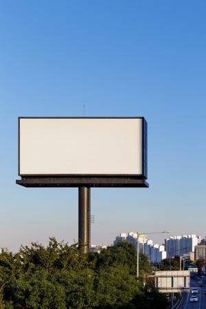 blank billboard: Blank billboard against blue sky Stock Photo