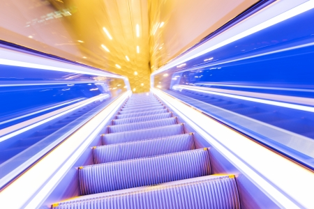 diminishing: Movement of diminishing hallway escalator Stock Photo