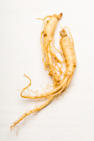 Ginseng over the white background photo