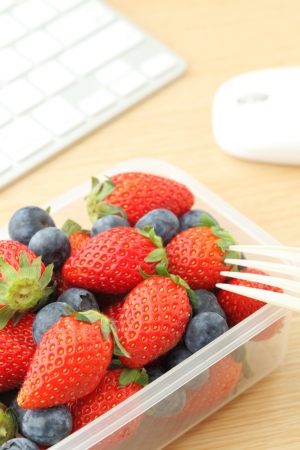 Healthy lunch on the working desk photo