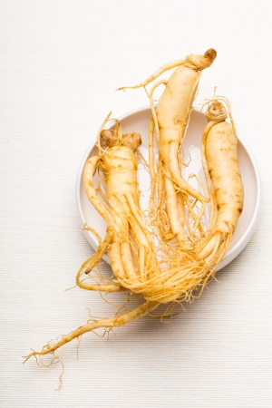 Fresh Ginseng over the white background photo