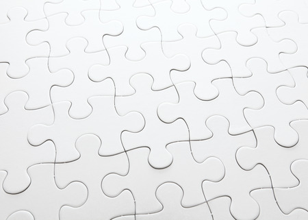 Complete white jigsaw puzzle Stock Photo