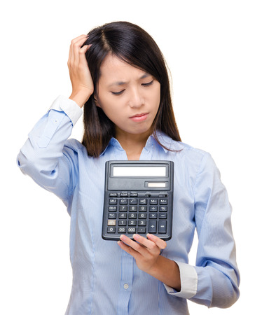 Asian woman feel sad and trouble with calculator Stock Photo - 24170290