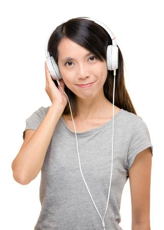 sone: Asian woman enjoy music with earphone Stock Photo