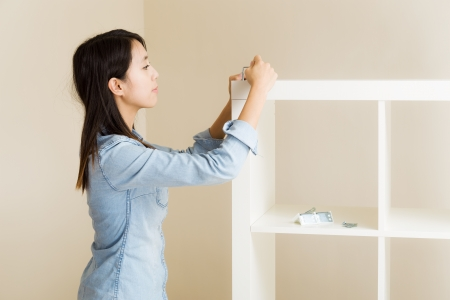 inlay: Asian woman inlay furniture by hand tool Stock Photo