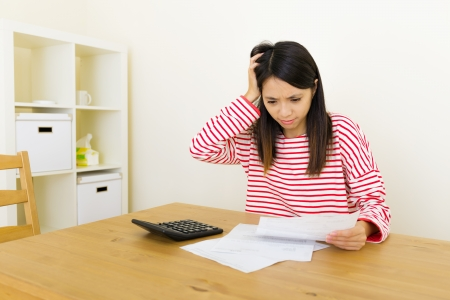 frustrate: Asian woman worries about the expenditure Stock Photo