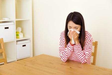 running nose: Asian woman sneezing Stock Photo