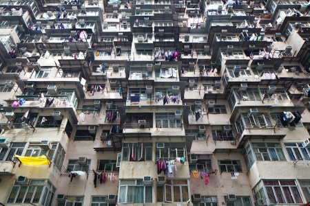 overpopulated: Overcrowded residential building in Hong Kong Editorial