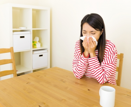 Asian woman with nose allergy Stock Photo - 24284176
