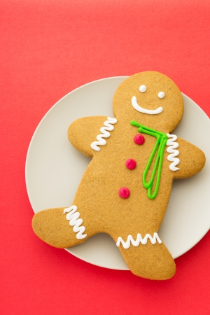 Gingerbread cookies with red background photo