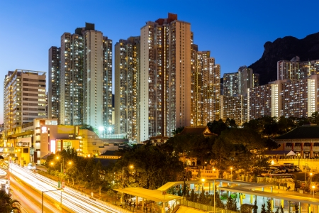 Kowloon with lion rock at night photo