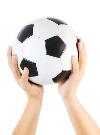 Hands holding soccer ball up isolated on white photo