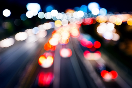 Blurred unfocused highway view at night photo