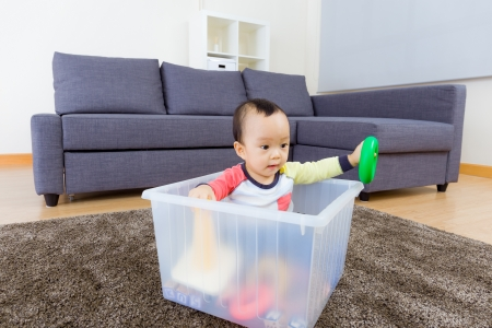 Asian baby boy playing at living room photo
