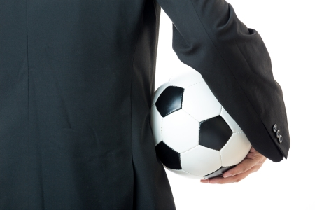 Businessman holding football photo
