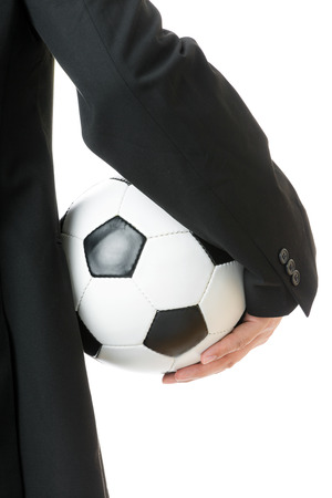 Businessman holding soccer ball isolated on white photo