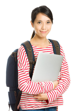Young student with computer and backpack isolated on white photo