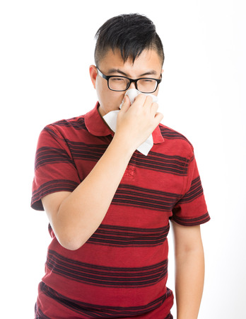 Asian man sneezing  photo