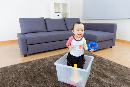 Asian baby boy playing at home photo