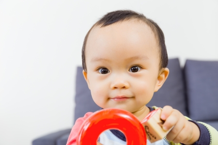 Asian baby boy playing toy photo