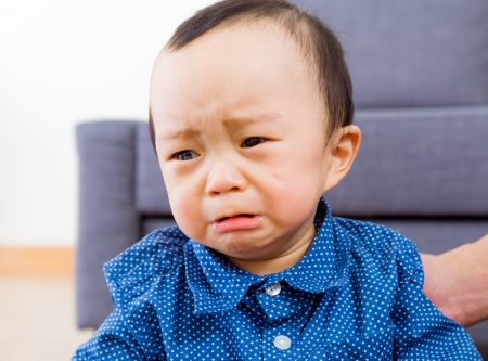 feeling sad: Asian baby boy feeling sad