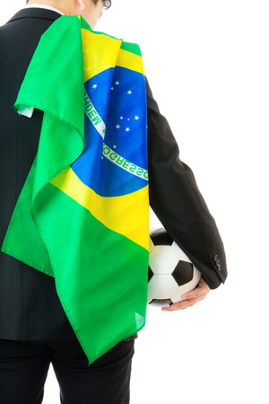 Businessman with soccer ball and brazil flag photo