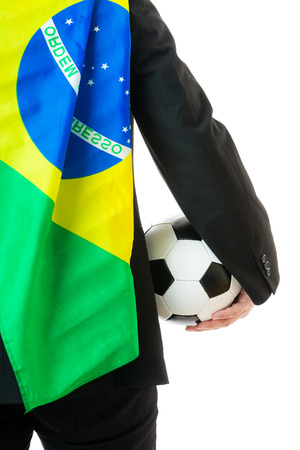 Businessman holding soccer ball and brazil flag photo