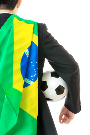 Back view of businessman with soccer ball and brazil flag photo