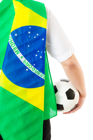 Back of businessman with football and brazil flag photo