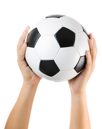 Hands holding soccer ball up photo