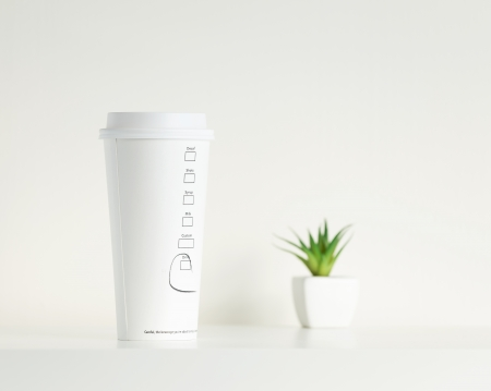 White coffe cup and green potted plant photo