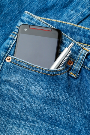 Jeans pocket with phone and pen photo