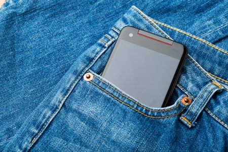 Blue jean pocket with mobile photo