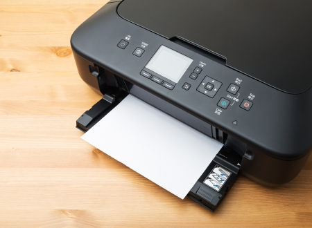Domestic printer and paper Stock Photo
