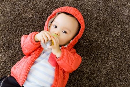 Baby boy feeding with milk bottom Stok Fotoğraf
