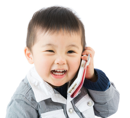 Asian baby boy talk to mobile photo