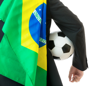 Businessman holding soccer ball and brazil flag photo