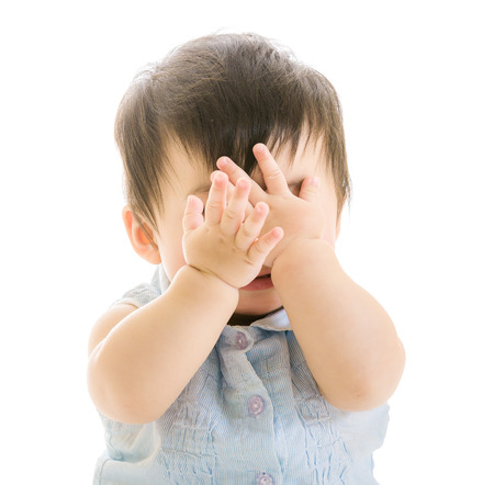 crying eyes: Baby covering eye Stock Photo