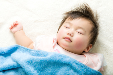 sleep baby: Asian baby girl sleeping Stock Photo