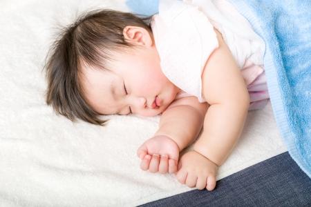 Asian baby girl fall asleep photo