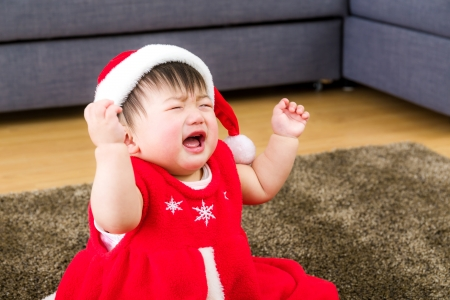 Asian baby girl with xmas dressing at home photo