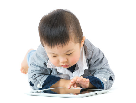 cubby: Little boy using tablet Stock Photo