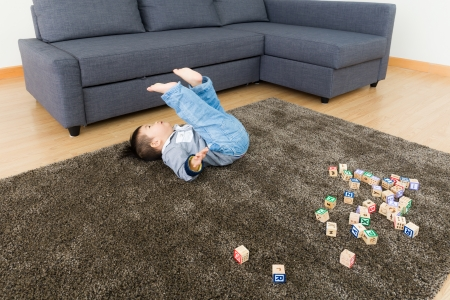 tumble down: Asian baby boy try to do somersault