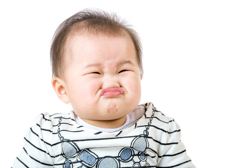 Asian baby girl make upset face photo
