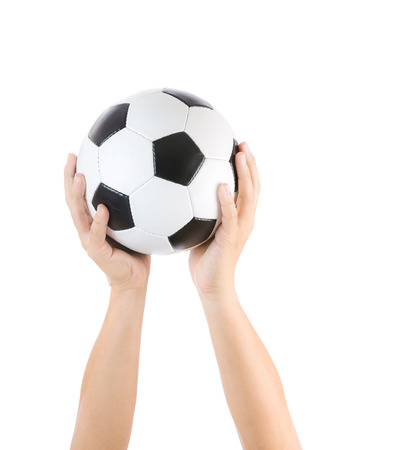 Hands holding soccer ball photo