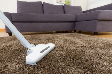 carpet texture: Carpet with vacuum cleaner in living room  Stock Photo